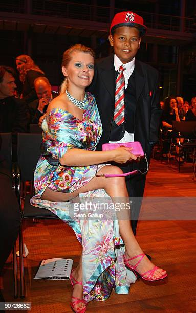 Actress AnneSophie Briest and her son Jahmar Walker attend the Victress Day Gala 2009 on September 14 2009 in Berlin Germany