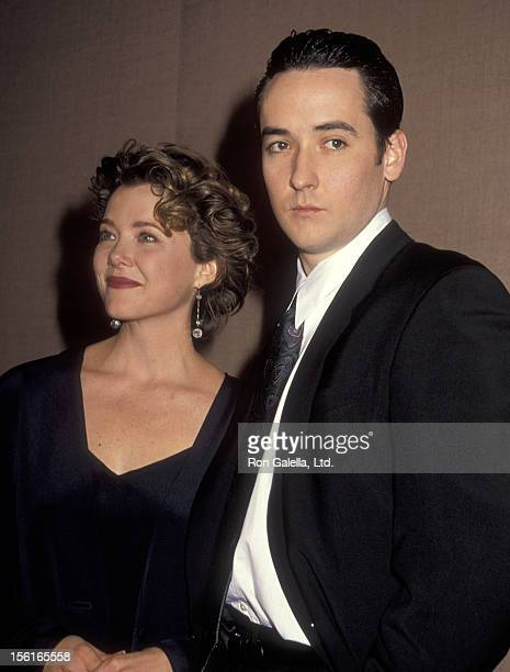 Actress Annette Bening and actor John Cusack attend the 49th Annual Golden Globe Awards on January 19 1991 at Beverly Hilton Hotel in Beverly Hills...
