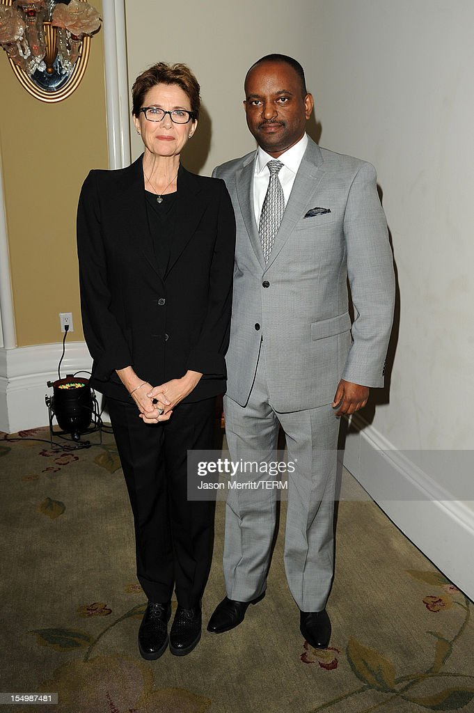 Actress Annette Bening and journalist Elias Wondimu attend the 2012 Courage in Journalism Awards hosted by the International Women's Media Foundation held at the Beverly Hills Hotel on October 29, 2012 in Beverly Hills, California.