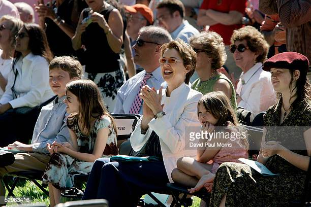 Actress Annette Bening listens to her husband actor Warren Beatty speak to the UC Berkeley Goldman School of Public Policy graduates as their...