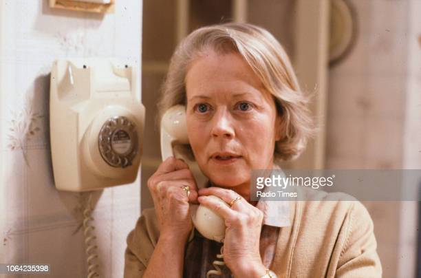 Actress Annette Crosbie talking on the telephone in a scene from episode 'The Eternal Quadrangle' of the BBC Television sitcom 'One Foot in the...