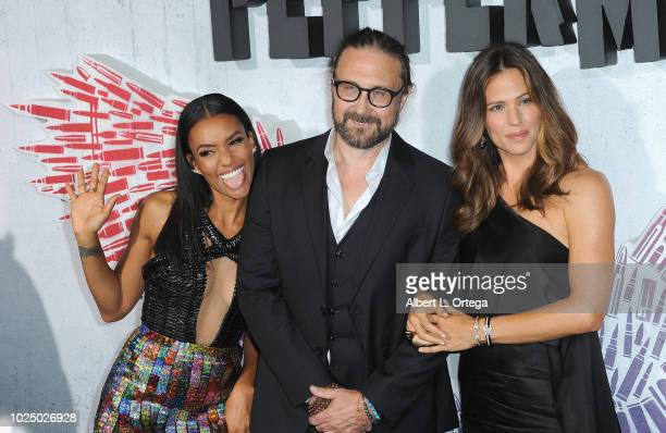 Actress Annie Ilonzeh director Pierre Morel and actress Jennifer Garner arrive for the Premiere Of STX Entertainment's Peppermint held at Stadium 14...