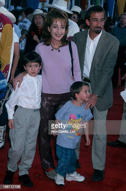 Actress Annie Potts husband James Hayman and sons Doc Hayman and Harry Hayman attending the world premiere of 'Toy Story 2' on November 13 1999 at...