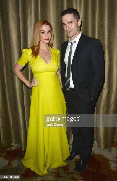 Actress Annie Wersching and actor Sam Witwer pose backstage at the Academy Of Science Fiction Fantasy Horror Films' 44th Annual Saturn Awards held at...