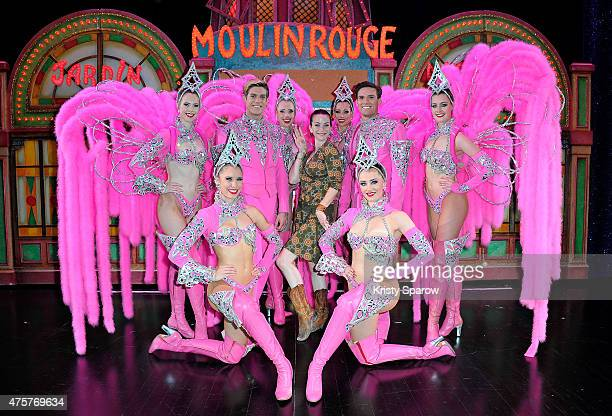 Actress Annie Wersching poses backstage with dancers at Le Moulin Rouge on June 3 2015 in Paris France