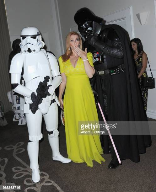 Actress Annie Wersching poses with A Storm Trooper and Darth Vader at the After Party at the Academy Of Science Fiction Fantasy Horror Films' 44th...