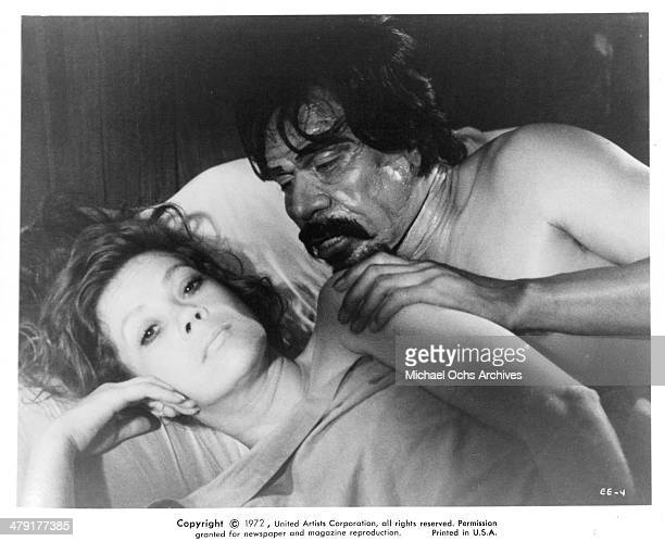 Actress Antoinette Bower and actor Craig Littler in bed in a scene from the Scifi movie 'Superbeast' circa 1972