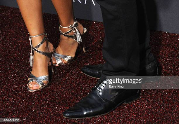Actress Antonia Thomas and actor RegeJean Page shoe detail attend the premiere of Disney's 'Queen Of Katwe' at the El Capitan Theatre on September 20...