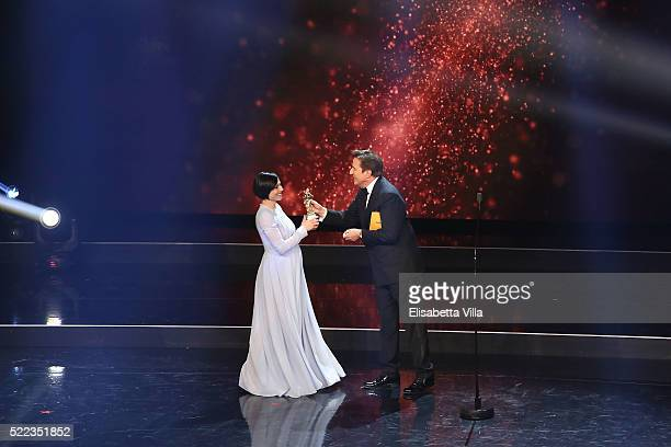 Actress Antonia Truppo receives the Best Supporting Actress award from Christian De Sica during the 60 David Di Donatello awards ceremony on April 18...