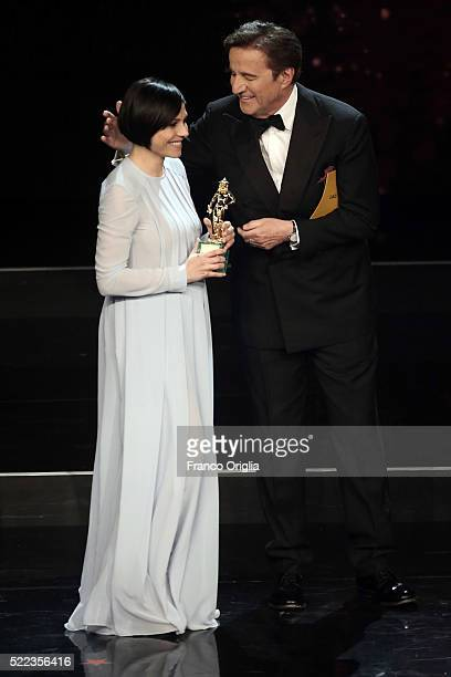 Actress Antonia Truppo receives the Best Supporting Actress award from Christian De Sica during the 60 David di Donatello Ceremony on April 18 2016...