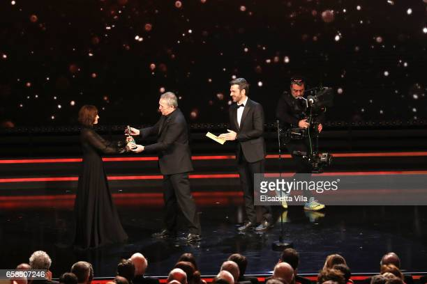 Actress Antonia Truppo receives the Best Supporting Actress award from Claudio Amendola and Luca Argentero during the 61 David Di Donatello ceremony...