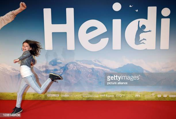 Actress Anuk Steffen runs across the red carpet during the German premiere of 'Heidi' in the Mathaeser Kino in Munich Germany 29 November 2015...