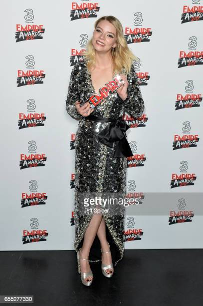 Actress Anya TaylorJoy poses with her award for Best Female Newcomer in the winners room at the THREE Empire awards at The Roundhouse on March 19...