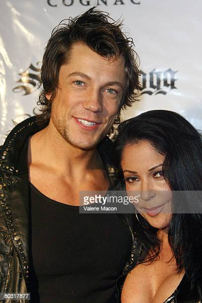 Actress Apollonia Kotero and actor Emmanuel Delcour attend MySpace Album Release Party for Snoop Dogg's 'Ego Trippin' at the Opera Crimson on March...