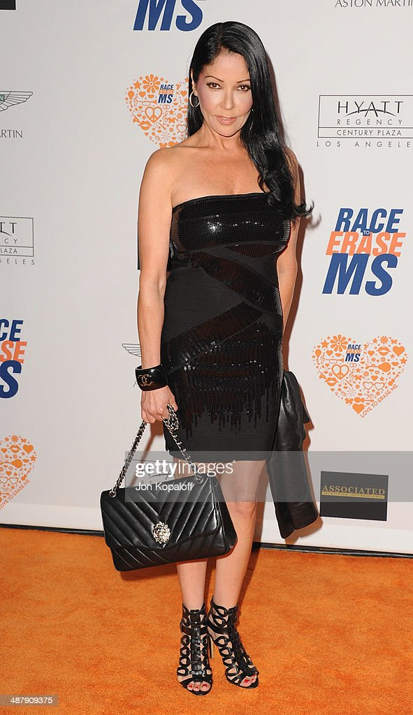 Actress Apollonia Kotero arrives at the 21st Annual Race To Erase MS Gala at the Hyatt Regency Century Plaza on May 2, 2014 in Century City, California.