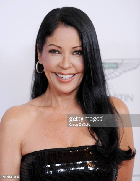 Actress Apollonia Kotero arrives at the 21st Annual Race To Erase MS Gala at the Hyatt Regency Century Plaza on May 2 2014 in Century City California