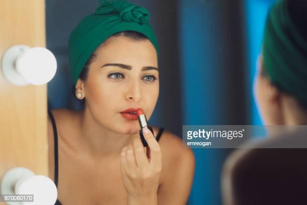 Actress Applies Makeup Backstage