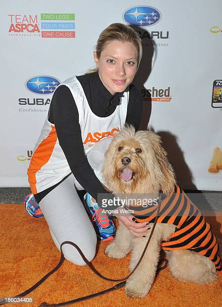 Actress April Bowlby and her dog Clementine attend the Rock 'n' Roll Los Angeles Halloween HalfMarathon benefitting The ASPCA at LA LIVE on October...