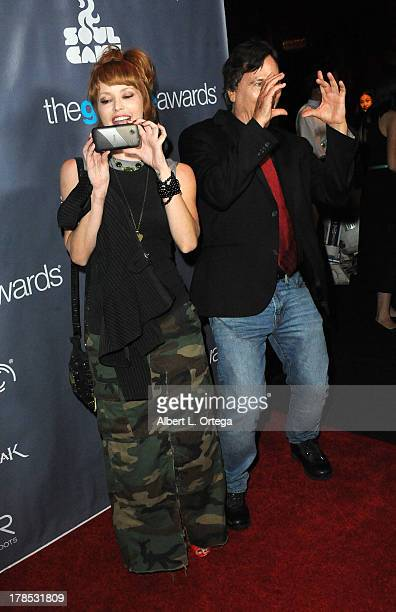 Actress April Eden and actor Richard Hatch attend The 1st Annual Geekie Awards held at Avalon on August 18 2013 in Hollywood California