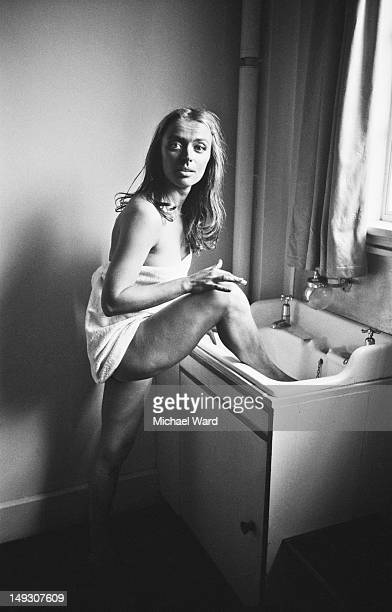 Actress April Olrich washes her feet in a sink inbetween takes of a movie circa 1960