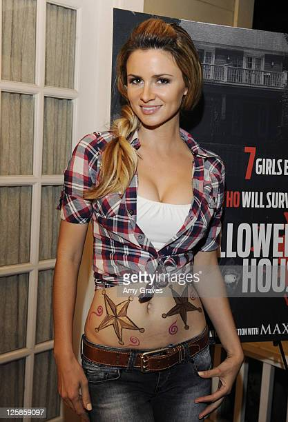 Actress April Rose attends the Maxim and Patriot Pictures Film 'Halloween House' Event on October 31 2010 in Los Angeles California
