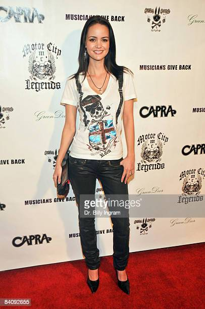 Actress April Scott attends the Musicians Give Back Charity Event at Green Door on December 16 2008 in Hollywood California