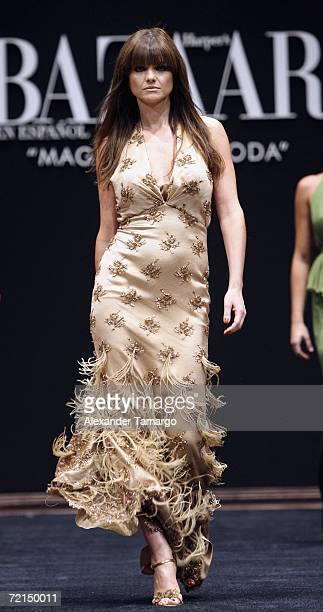 Actress Araceli Gonzalez walks the runway during the Harper's Bazaar en Espanol Collection at the Carnival Center for the Performing Arts during...