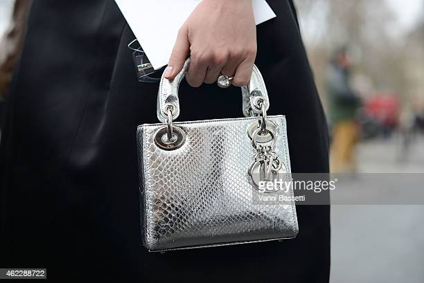 Actress Araya Alberta Hargate poses wearing a Dior bag during day two of Paris Haute Couture Spring Summer 2015 on January 26 2015 in Paris France