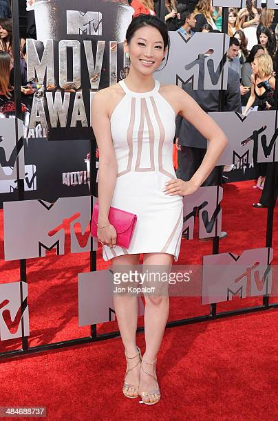 Actress Arden Cho arrives at the 2014 MTV Movie Awards at Nokia Theatre LA Live on April 13 2014 in Los Angeles California