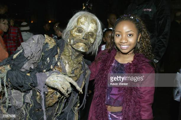 Actress Aree Davis poses with a ghoul at the afterparty for 'The Haunted Mansion' at the El Capitan Theater on November 23 2003 in Los Angeles...