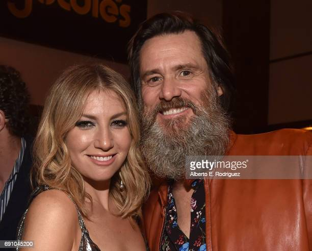 Actress Ari Graynor and executive producer Jim Carrey attend the after party for the premiere of Showtime's 'I'm Dying Up Here' at Canter's Deli on...