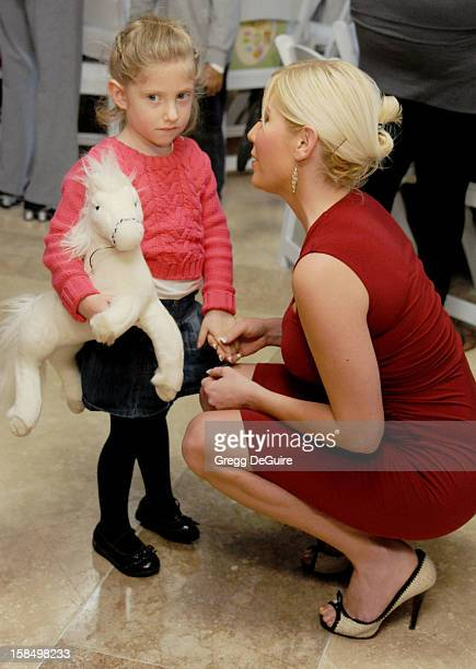 Actress Ariane Bellamar and daughter Emma arrive at the Working Dreams And Families For Children annual holiday celebration at the Marriott Courtyard...