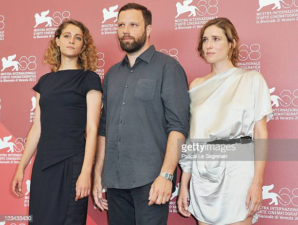 Actress Ariane Labed YorgosLanthimos and Aggeliki Papoulia pose at the Alpis photocall during the 68th Venice Film Festival at the Palazzo del...