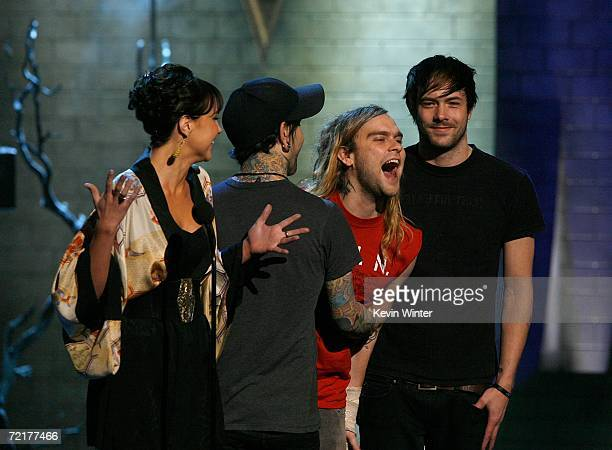 Actress Ariel Kebbel and The Used present the award for 'Killer Video' on stage during the fuse Fangoria Chainsaw Awards at the Orpheum Theater on...