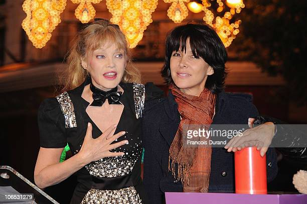 Actress Arielle Dombasle and journalist Tina Kieffer attend the launch of the Christmas animation and light window display at Galeries Lafayette on...