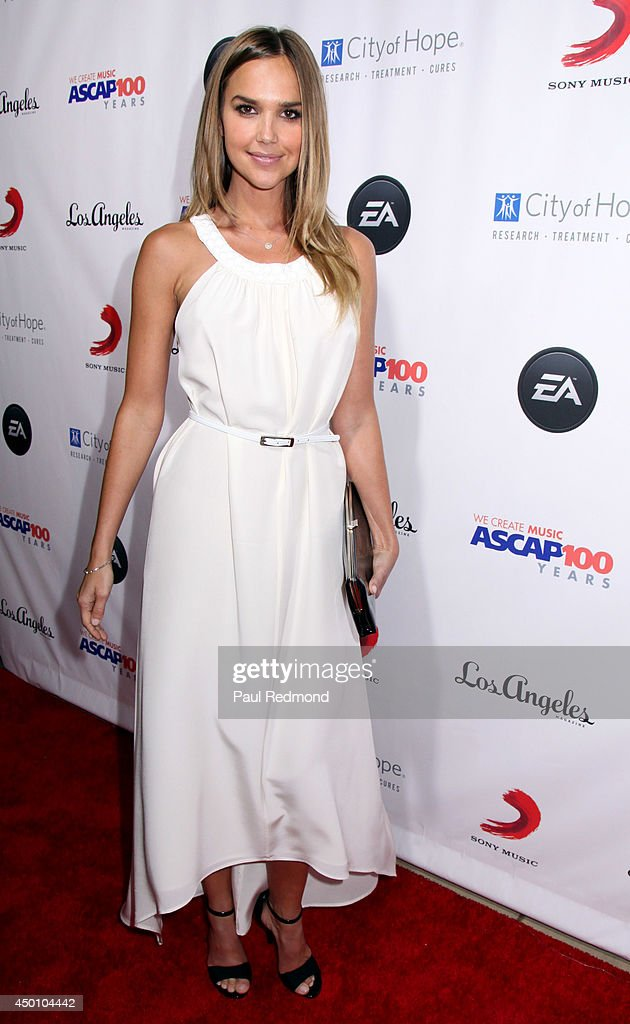 Actress Arielle Kebbel arriving at Songs Of Hope X 10th Anniversary Event Benefiting City Of Hope at House of Fair on June 4, 2014 in Brentwood, California.