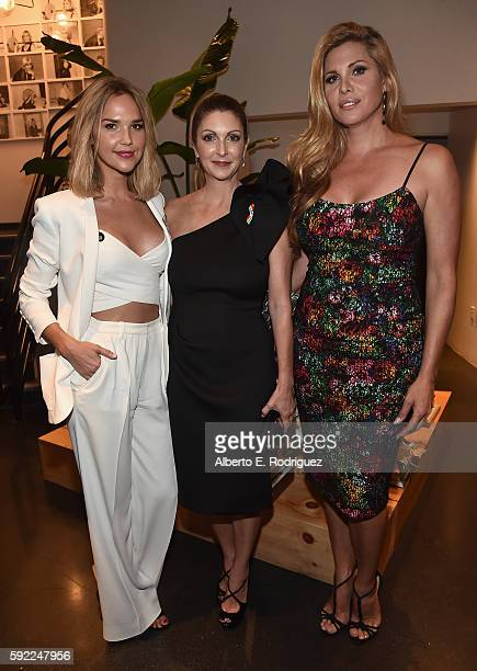 Actress Arielle Kebbel Pulse Nightclub and onePULSE Foundation founder Barbara Poma and actress Candis Cayne attend a cocktail reception Benefit for...