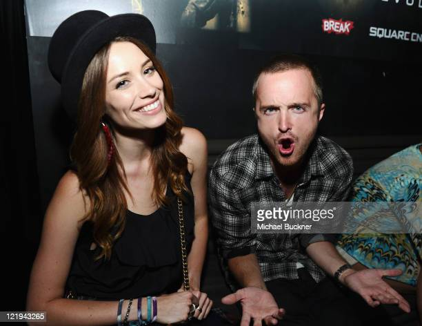 Actress Arielle Vandenberg and actor Aaron Paul attend the Deus Ex: Human Revolution Video Game Launch Party Hosted by Break.com at Roxbury on August...