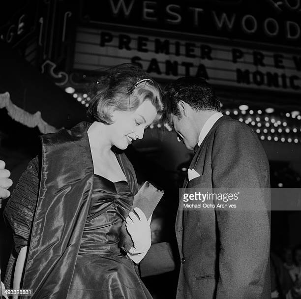 Actress Arlene Dahl and actor Fernando Lamas attends a premiere in Los Angeles California