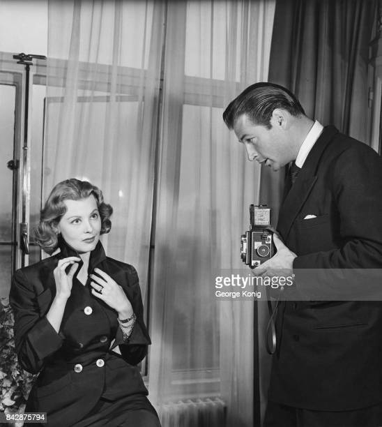 Actress Arlene Dahl poses for her husband actor Lex Barker May 1951