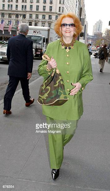 Actress Arlene Dahl walks down 59th Street near Fifth Ave after having lunch with a girlfriend at Cipriani's restaurant December 6 2001 in New York...