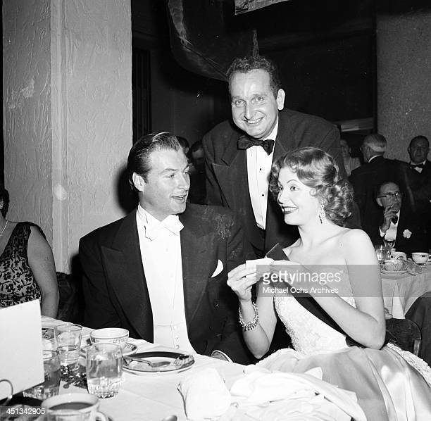 Actress Arlene Dahl with Lex Baker and Jose Jard attend the Foreign Press Awards in Los Angeles California