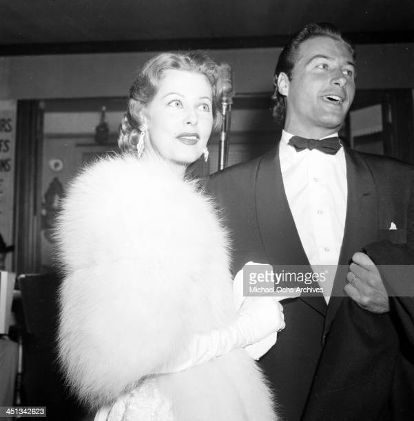 Actress Arlene Dahl with Lex Barker arrives at a party in Los Angeles California