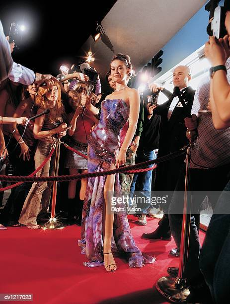 actress arriving at a movie premiere surrounded by paparazzi - film premiere stock pictures, royalty-free photos & images