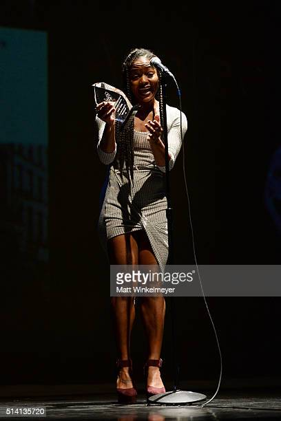 Actress Ashlee Olivia Jones accepts an award onstage during the 25th annual NAACP Theatre Awards press conference at The Ebony Repertory Theatre on...
