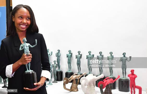 Actress Ashleigh LaThrop holds a statue of the Screen Actors Guild Award known as 'the Actor' at the American Fine Arts Foundry on January 7 2020 in...