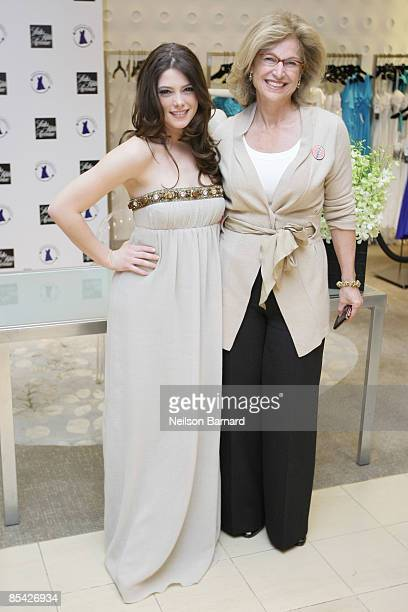 Actress Ashley Greene and Senior VP and GM of Saks Fifth Avenue, Suzanne Stemper Johnson pose for a photograph at the DonateMyDress.org event at Saks...