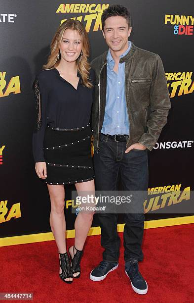 Actress Ashley Hinshaw and actor Topher Grace arrive at the Los Angeles Premiere 'American Ultra' at Ace Theater Downtown LA on August 18 2015 in Los...