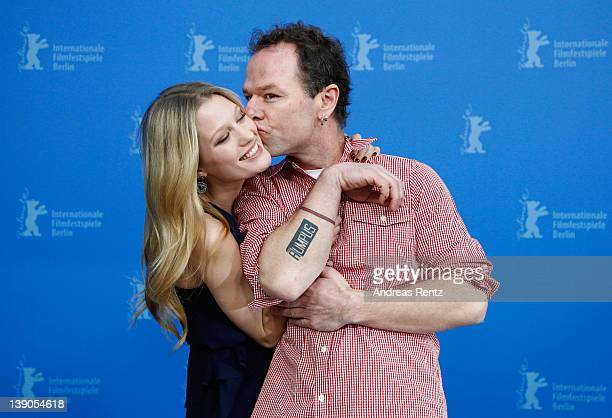 Actress Ashley Hinshaw is kissed by director Stephen Elliott as they attend the Cherry Photocall during day eight of the 62nd Berlin International...