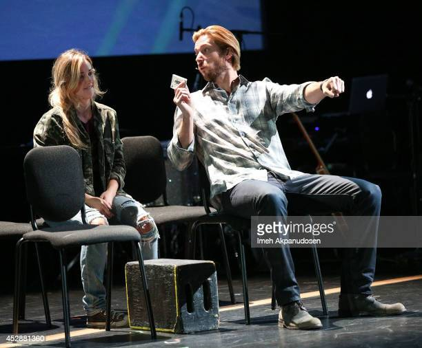 Actress Ashley Johnson and actor Troy Baker perform onstage during The Last of Us One Night Live reading and performance at The Broad Stage on July...
